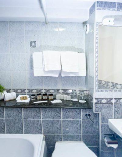 Bathroom with bath at Dublin Citi Hotel