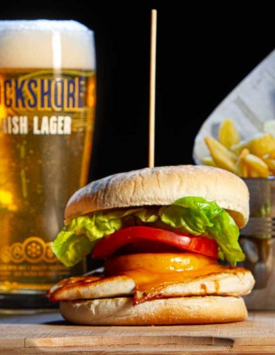 Chicken burger with fries and a Rockshore pint