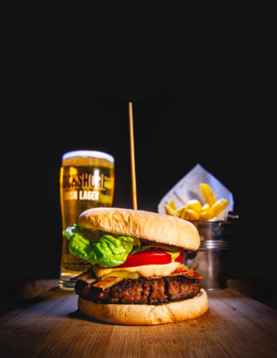 Beef burger with fries and a Rockshore pint